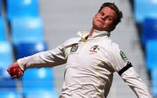 Australian cricketer Steven Smith bowls during day one of the first cricket test match against Pakistan in Dubai on 22 October, 2014. Picture: AFP.
