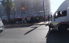 A blaze broke out at a block of flats along Voortrekker Road shortly after 12 pm in Bellville. Picture: Abongile Nzelenzele