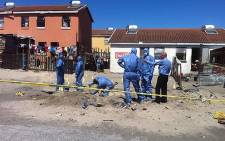 Police forensics dig behind the Mitchells Plain homes of Shaskia Michaels and Kauthar Bobbs on 18 October 2013. Picture: Siyabonga Sesant/EWN
