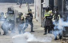 Venezuelan police clash with opposition activists during a protest against the government of President Nicolas Maduro on 6 April 2017 in Caracas. Picture: AFP.