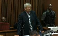 Ballistics expert Wollie Wolmarans tesifies at the Oscar Pistorius trial on 8 May 2014.