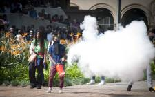 A student uses a fire extinguisher to create cover during skirmishes with private security at Senate House at Wits University. Picture: Nina Leslie/i-Witness