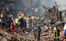 Rescuers and firefighters work at the scene of the crashed Dana Airline plane in the densely populated Toyin Area of Iju Ishaga in Lagos, on June 4, 2012. Picture: AFP.