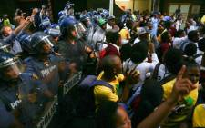 Police officers keep a watch on protesting Cosas members in Cape Town's CBD. Picture: Thomas Holder/EWN.