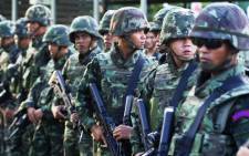 FILE: Thai soldiers stand guard after army chief General Prayut Chan-O-Cha met with anti-government and pro-government leaders at the Army Club in Bangkok on 22 May 2014. Thailand's army chief announced in an address to the nation that the armed forces were seizing power after months of deadly political turmoil. Picture: AFP.