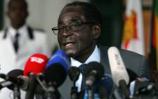 Zimbabwe's President and Zanu PF Presidential candidate Robert Mugabe speaks at a press briefing on 30 July 2013 at the State House a day ahead of the general election in Zimbabwe. Picture: AFP.