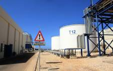A picture shows storage tanks at the Zahrani power plant in Zahrani near the southern Lebanese city of Sidon (Saida) on September 18, 2021, as an oil tanker carrying fuel oil from Iraq, empties it's load at the power plant. Iraq will provide Lebanon with one million tonnes of fuel oil for its power plants in exchange for medical services, under a deal signed in July in Baghdad. Picture: Mahmoud Zayyat / AFP