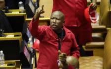 Economic Freedom Fighters (EFF) leader Julius Malema objects as South African President Cyril Ramaphosa attempts to deliver his State of the Nation Address at Parliament in Cape Town on 13 February 2020. Picture: AFP