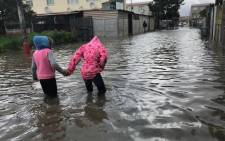 Cape Town heavy rainfall left the streets of Hanover Park flooded. Some residents are trapped in their homes. Picture: Monique Mortlock/EWN.