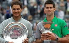 Rafael Nadal (L) and Novak Djokovic (R) hold their Rome Masters trophies aloft. Picture: Facebook.com