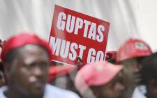 EFF members hold up placards at the Constitutional Court in Johannesburg during the Nkandla showdown on 09 February 2016. Picture: Reinart Toerien/EWN.