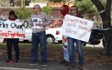 Firefighters picket outside the Lakeside fire station for better pay. Picture: Bertram Malgas/EWN