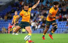 A file photo taken on 12 September 2021 shows Australia's Quade Cooper kicking a penalty as he leads Australia to victory in the Rugby Championship match against South Africa at Cbus Super Stadium on the Gold Coast. Picture: Patrick Hamilton/AFP
