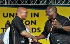 ANC president Jacob Zuma and his deputy Cyril Ramaphosa shake hands after being elected to the ANC's top six on 18 December 2012 in Mangaung. Picture: ANC