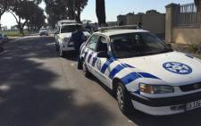Police monitor a peaceful march staged by Pagad and community members in Mitchells Plain against gangsterism and drugs on Saturday 5 September 2015. Picture: Natalie Malgas/EWN
