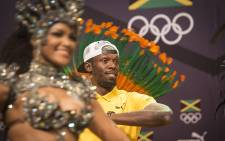 Jamaican sprinting legend Usain Bolt dances with Brazilian dancers after a press conference at the Cidade Das Artes in Rio de Janeiro ahead of the 2016 Olympic games in Brazil. Picture: Reinart Toerien/EWN