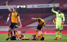 Arsenal defender David Luiz (L) and Wolverhampton Wanderers' striker Raul Jimenez lay injured after clashing heads during the English Premier League football match between Arsenal and Wolverhampton Wanderers at the Emirates Stadium in London on 29 November 2020. Picture: AFP