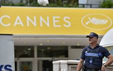 A French police officer stands guard in front of the Festival Palace in Cannes on 10 May 2016, on the eve of the beginning of the 69th Cannes film festival. Picture: Loic Venance/AFP.