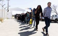 Syrian refugees arrive at the Kokkinotrimithia refugee camp, some 20 kilometres outside the Cypriot capital Nicosia, on September 10, 2017, after they were rescued off the northwestern coast of the island. Picture: AFP.