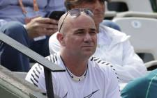 Coach Andre Agassi watches Novak Djokovic playing against Joao Sousa during their tennis match at the Roland Garros 2017 French Open on 31 May 2017 in Paris. Picture: AFP.