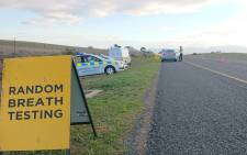 A Western Cape traffic official conducts a random breath testing on the N2 highway. Picture: @WCGovSafelyHome/Twitter.