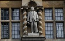 In this file photo taken on 9 June 2020 A statue of British businessman and imperialist Cecil John Rhodes is pictured outside Oriel College at the University of Oxford in Oxford, west of London, during a protest calling for its removal. Picture: AFP