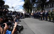 Colombia's President Ivan Duque (4-R) addresses the press next to Vice President Marta Lucia Ramirez (C), at a police cadet training school in Bogota after a car bomb attack took place at the academy leaving at least nine people dead and 54 injured, on 17 January 2019. Picture: AFP