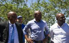 Herman Mashaba, DA leader Mmusi Maimane and Solly Msimanga during a walkabout in Diepsloot. Picture: Kayleen Morgan/EWN