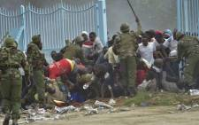 Kenyan police intervene outside the Kasarani stadium in Nairobi during a stampede as supporters of Kenya's president Uhuru Kenyatta try to get into the venue to attend his inauguration ceremony on 28 November, 2017. Picture: AFP