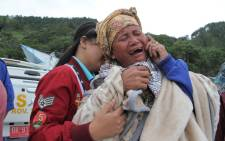 A woman cries as she finds out her family is one of missing passengers at Lake Toba ferry port in the province of North Sumatra, after a boat overturned. Picture: AFP