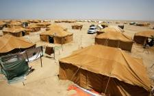 A makeshift camp for internally displaced Iraqis who have fled the ongoing conflict between pro-government forces and Islamic State group jihadists, in Ameriyat al-Fallujah, 30 km south of Fallujah, on 25 May 2015. Picture: AFP.