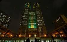 The Tokyo municipal government headquarters are pictured lit in the yellow and green colours of Brazil's flag in celebration of the 100 days before the 2016 Rio Olympics in Tokyo, Japan. Picture: Twitter @ReutersIndia.