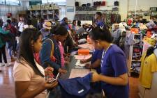 FILE: Parents get school uniforms for their children ahead of the start of the new Western Cape school year on 17 January, 2018. Picture: Bertram Malgas/EWN