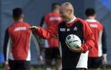 FILE: Japan's head coach Eddie Jones (C) attends a team training session at Brighton College in Brighton, on September 17, 2015, on the eve of the opening match of the 2015 Rugby Union World Cup. Picture: AFP.