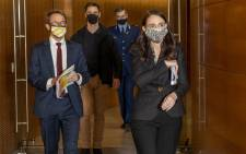 New Zealand's Prime Minister Jacinda Ardern (R) and Ashley Bloomfield (L), chief executive of the Ministry of Health, arrive to speak about COVID-19 coronavirus on the first day of a snap national lockdown, during a press conference in Wellington on 18 August 2021. Picture: Mark MITCHELL/AFP