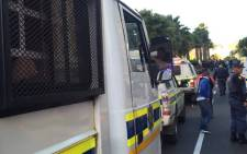 Police cars line-up the street in Stellenbosch to monitor the students protests in the amid tensions on 22 October 2015. Picture: Siyabonga Sesant/EWN.