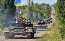 FILE:Ukrainian troops patrol near the village of Novoselovka, some 30km from the eastern Ukrainian city of Donetsk, on 31 July, 2014. Picture: AFP.