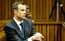 Oscar Pistorius sits in court on 24 March 2014 as the fourth week of his trial starts. Picture: Pool.