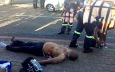 Emergency services at the scene of a shooting in Randburg which left one man dead, 30 May 2014. Picture: Leeto Khoza/EWN.