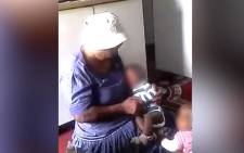 A screengrab of a woman allegedly abusing a baby at a Diepsloot creche.