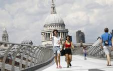 A couple walks over The Millennium Bridge away from St Paul's Cathedral in London on 26 June 2020. Picture: AFP