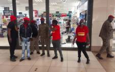 Economic Freedom Fighters (EFF) members gather at a Clicks store at Thabong mall in Sebokeng on 7 September 2020 to protest the use of a racist advert on its website. Picture: EWN