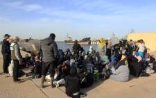 Illegal immigrants wait at a naval base in the Libyan capital Tripoli 7 January 2018, after they were rescued off the coast of Garabulli, 60 kilometres east of the capital. Picture: AFP