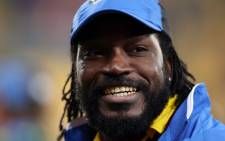 West Indies Chris Gayle smiles after the Quarter Final Cricket World Cup match between New Zealand and the West Indies played at the Wellington Regional Stadium in Wellington on 21 March 2015. Picture: AFP/Michael Bradley.