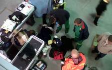 Cape Town paramedics attend to a cashier who was shot and wounded during a robbery at a Makro store in Ottery on 14 July, 2012. Picture: Charlene Le Roux/EWN