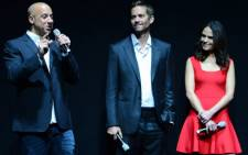 (L-R): Actors Vin Diesel and Paul Walker and actress Jordana Brewster attend a Universal Pictures presentation to promote their upcoming film Fast & Furious 6 at The Colosseum at Caesars Palace during CinemaCon on 16 April 2013 in Las Vegas, Nevada. Picture: AFP/Ethan Miller/Getty Images