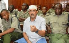 Ivory Kingpin Feisal Mohamed Ali follows is pictured during his successful 20 year sentence appeal at a Mombasa Court on 3 August 2018. Picture: AFP