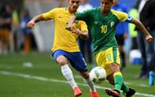 Brazil's Zeca (L) tracks South Africa's Keagan Dolly during their Rio 2016 Olympic Games football match at the Mane Garrincha Stadium in Brasilia on August 4, 2016. Picture: AFP