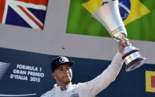FILE: Mercedes AMG Petronas F1 Team's British driver Lewis Hamilton celebrates with his trophy on the podium after winning the Italian Formula One Grand Prix at the Autodromo Nazionale circuit in Monza on 6 September 2015. Picture: AFP