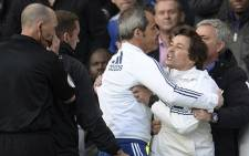 Chelsea assistant coach Rui Faria (second right) is restrained by Jose Mourinho and another member of the Chelsea staff. Picture: Facebook.com